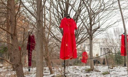 Red dresses displayed around American Indian museum to memorialize missing, murdered native women